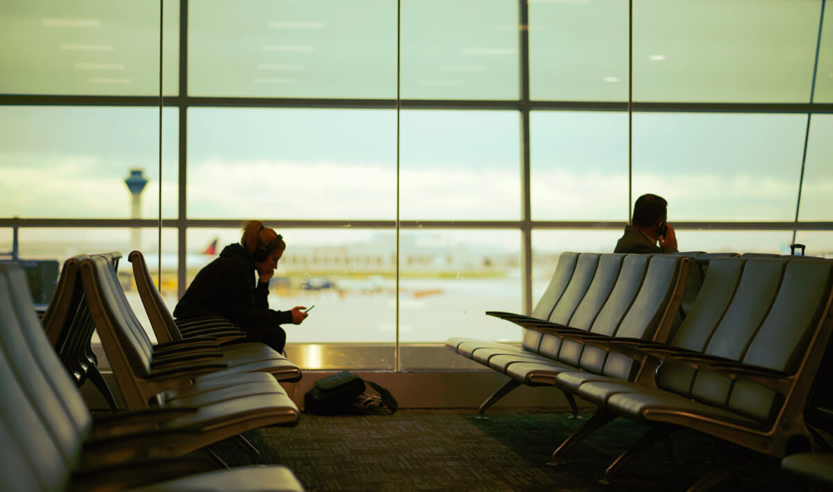 man sitting in airport